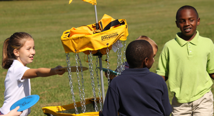 Each year at the USDGC, area shcool children get to experience disc golf, many for the first time.