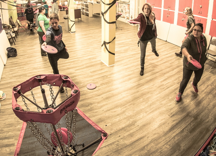 The Throw Pink putting clinic happened inside because of the rain.