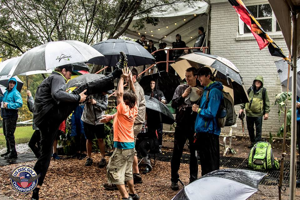 Players and fans with umbrellas in tow preparing the final round in 2015