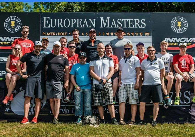 Munukka pictured (front right) with staff from European Masters