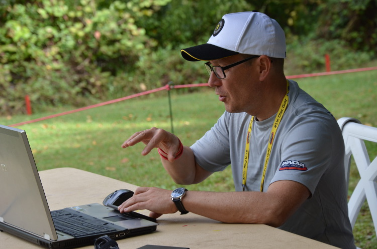 At the USDGC Munukka has been involved in scoring and the Metrix stats. Here he is stationed by Hole 18.