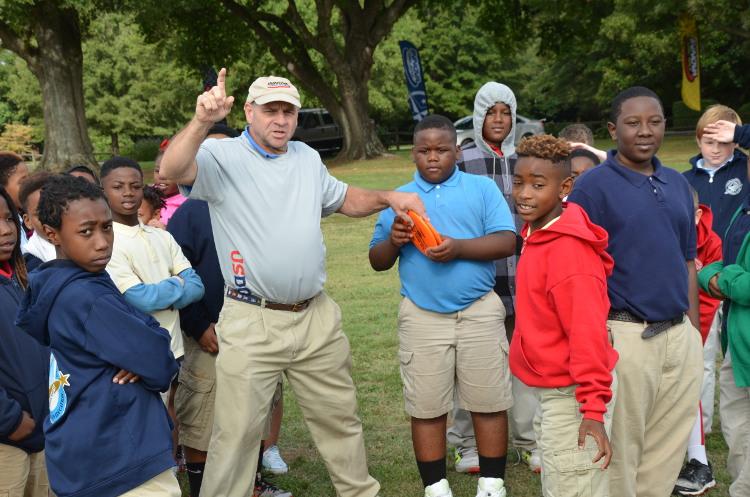Lambert demonstrates disc golf skills at the USDGC EDGE Village on Thursday