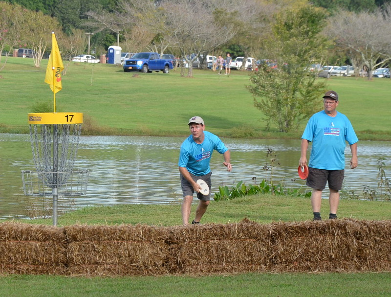 Chris Sauls and Jay Sauls finish out Hole 17 during Friday's Round 1 of USDGC Doubles.