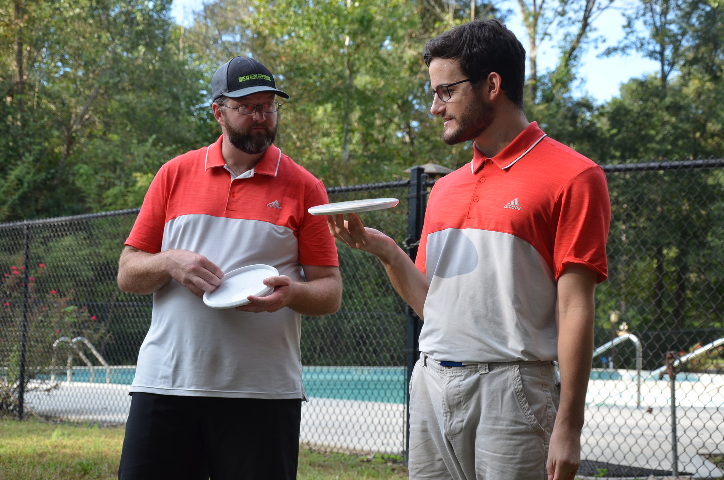 James Hopkins (left) and Aaron Shindledecker get to know their trophy discs after winning USDGC Doubles for the second time in a row.