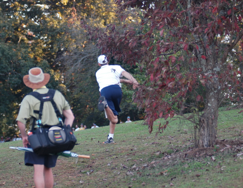 Disc Golfer and Spectator